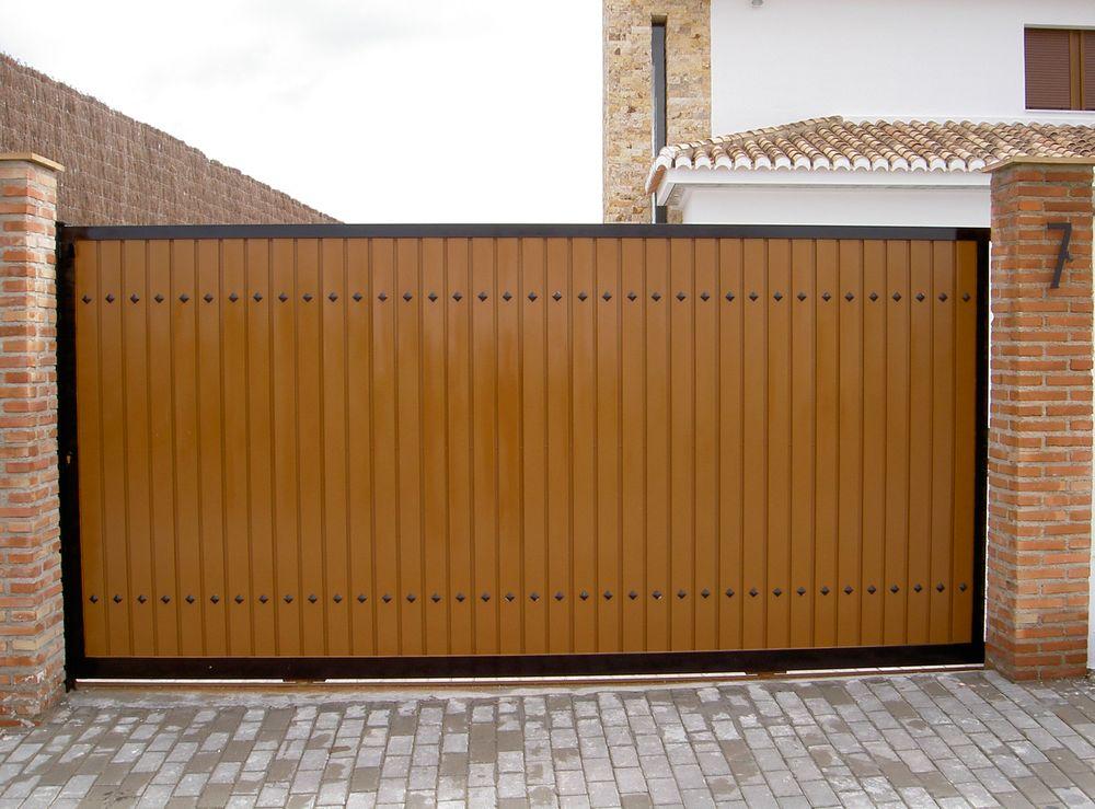 Puerta corredera garaje ar puertas alberto rodr guez for Puerta corredera de castorama corredera