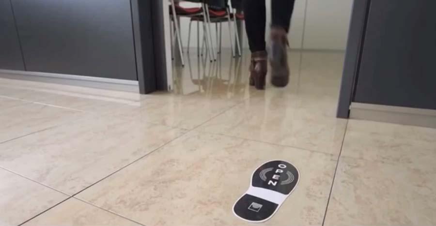 Sistema de apertura sin contacto para suelo